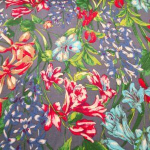 Elasztikus pamutszövet  – Virágözön világoskék alapon