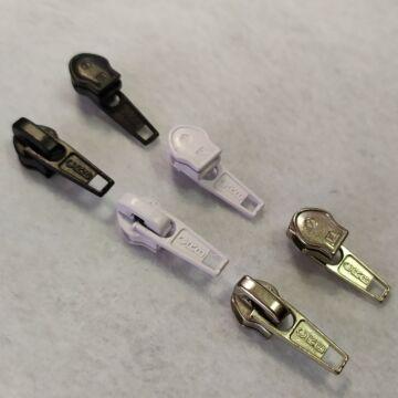 Cipzár húzóka – RT10-es, fekete, fehér és nikkel színben, fékezős