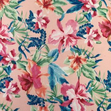 Kötött piké – Halvány rózsaszín alapon, trópusi virágok