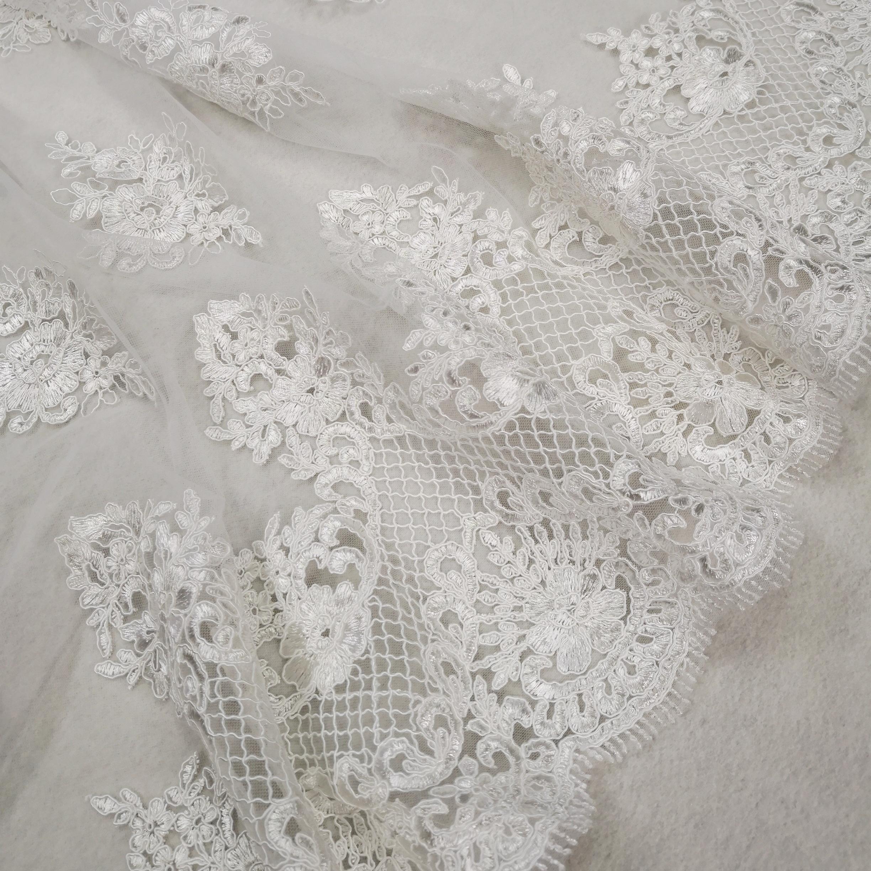 fe0ca0589e Tüll csipke – Fehér színű hímzett mintával, bordűrös